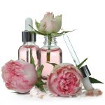 bigstock rose essential oil isolated on 421482113